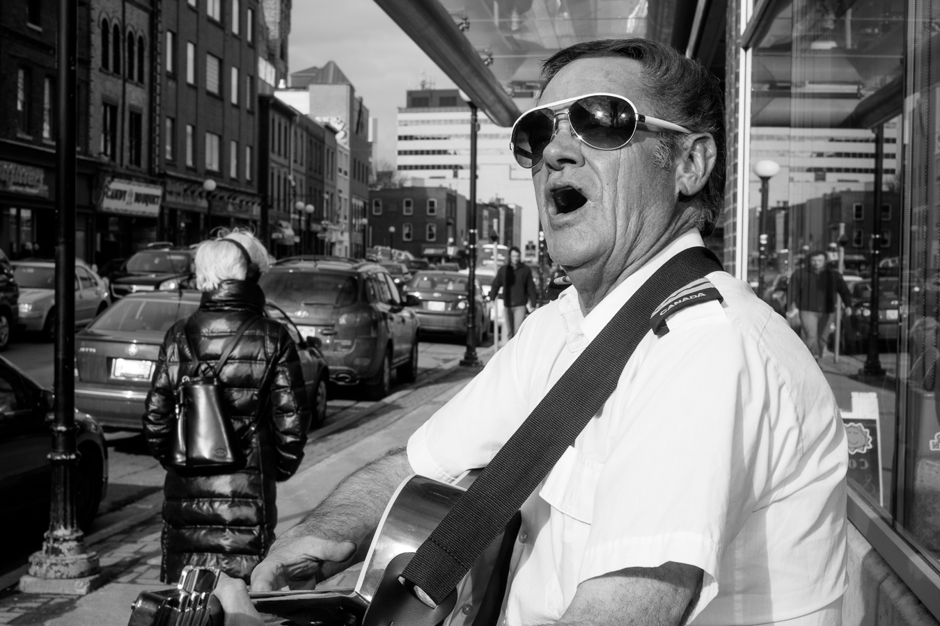 This guy harasses more than busks, He's got a monster of a voice - Atlantic Place - water street