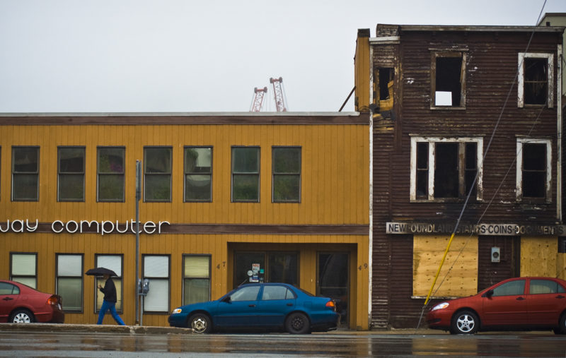 A rainy day following a large building fire that gutted the building to the right - New Gower Street