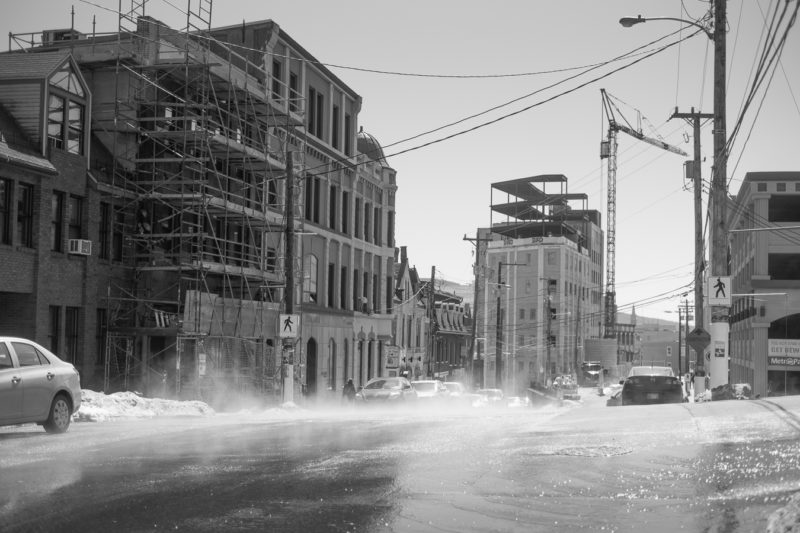 Construction and refurbishment happening while the sun evaporates the fog from our last snow milting - Duckworth street at Church hill