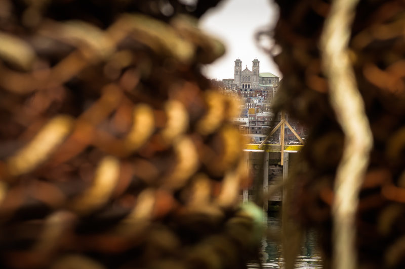 A View of the St. John's Basillica through a set of lobster pots - Southside Road