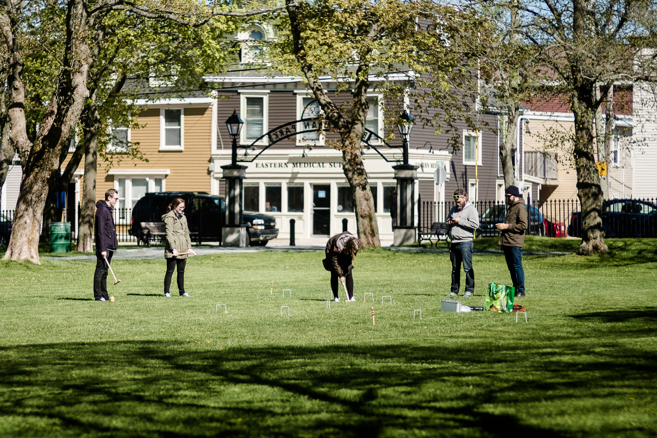 Members of Perfect Day Design Studio have a game of croquet  - Bannerman Park
