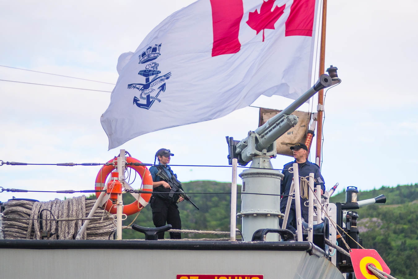 Standing guard for thee -  atop the deck of the St. John's - St. John's