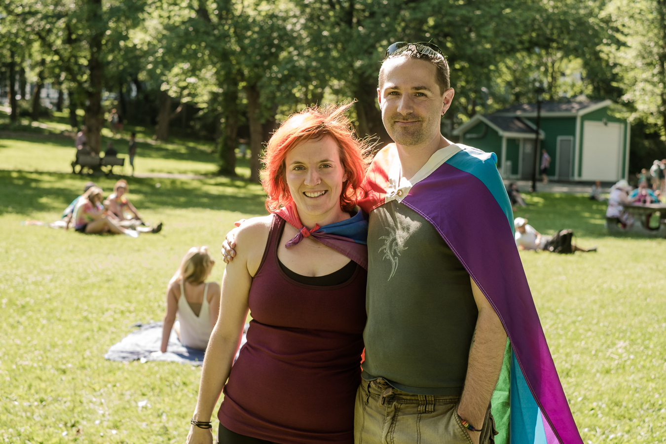 Krista and Christopher show their support by flying the flag as capes - bannerman park
