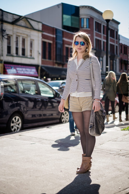 A stylish young lady poses on a sunny afternoon - water street